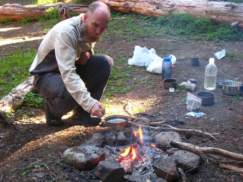 Hippie cooks breakfast.