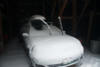 Even inside the barn, the car gets a blanket of snow.