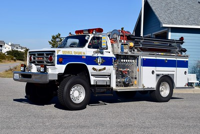 "Corolla's Engine 64 was re-designated as ""Service Engine 64"" since last photographed.    This 1987 GMC 7000 4x4/E-One, 750/500, sn- 6016 is now in reserve status."