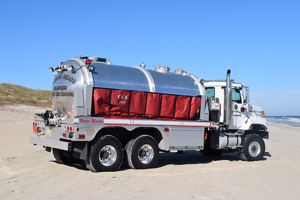 Tanker 71 is a large 2006 International Paystar 5000 4x4/2007 Garsite Progress/Water Master.  A vacuum style tanker equipped with a 650/4000.  Also equipped with a 4,000 gallon folding tank.