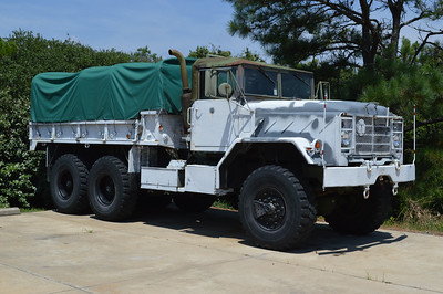 Flooding in the OBX area is always a possibility with the chances of hurricanes and storms.  A variety of department's in the area operate old military vehicles that are better equipped to assist in these situations.  This is Corolla's Storm 6, which is kept at the department's Corolla station.  Storm 6 is a 1991 BMY M923A2 a5 ton 6x6.  It originally served Red River Army Depot TACOM and also Ft. Eustis, Virginia.  It was delivered to Corolla via the NC Forestry Department.