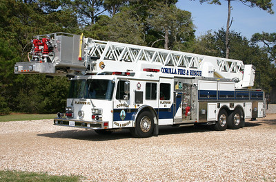 Corolla Platform 61, a 1990 Duplex/Grumman/2009 KME 102' with 1500/200 and serial number 18292.  The 2009 KME rehab included the pump, outriggers, rebuild of the ladder/bucket, and an automatic stabilization system.  Photographed in 2012 at the Corolla Light House.
