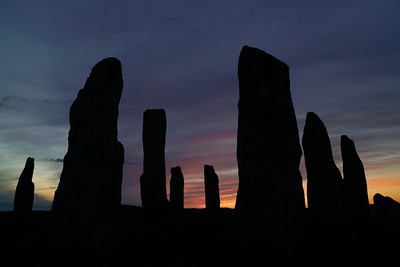 Silhoutte of the callanish stones at sunset, located on the isle of Lewis, Outer Hebrides, Scotland.