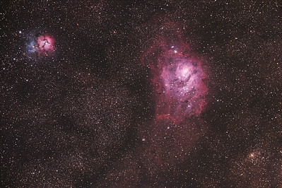 M20 - The Trifid Nebula (left) & M8 - The Lagoon Nebula (right) - About 5200 light years toward the center of the Milky Way lies this complex of stars and gas.  Many deep space objects and thousands of stars of all types can be seen here.  The Trifid Nebula appears to us as a combination of both emission (red) and reflection nebulae (blue) but it is really two separate objects.  The blue reflection nebula lies behind the red area and is farther away.  A small cluster of stars can also be seen at lower right.  This image was composed from several master images ranging from thirty seconds to seven minutes in duration for a total of just over 8 hours of exposure.  Taken  June 20-27 2009.  ----------  Field center: RA: 18:04:36.766, DEC: -23:56:8.713 Field size: 2.73 x 1.82 degrees Camera: Modified Canon 300D DSLR @ 800 ISO Filter: None Lens: 80mm Apo F/stop: 6.1