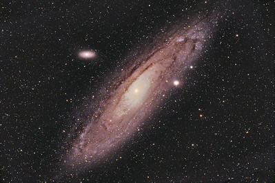 "M31 is a member of our local group of galaxies and is the closest large galaxy to the Milky Way at a distance of about 2.5 million light years.  It is estimated to be twice the size of our galaxy and to contain over 1 trillion stars.  This image also contains two of Andromeda's companion galaxies M32 and M110.  This galaxy is moving toward us at about 186 miles per second.  At its center is a halo of superheated gas and material that surrounds a super massive black hole.  Even though this is a very large object in the sky - over three times the angular dimension of the full moon - it exhibits low surface brightness and requires a lot of exposure to reveal the detail within the dust lanes and spiral arms.  Taken early fall 2009.  ----------  Field center: RA: 00:42:46.518, DEC: +41 degrees 15' 28.541"" Field size: 2.73 x 1.82 degrees Camera: Modified Canon 300D DSLR @ 800 ISO Total Time: 9 hours and 13 minutes Filter: None Lens: 80mm Apo F/stop: 6.1"