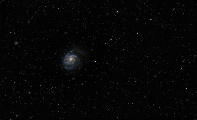 M101 - The Pinwheel Galaxy is one of the largest disk galaxies known.  It has an estimated distance of about 24 million light years and is roughly 170,000 light years in diameter with an estimated mass of about 30 billion suns.  This is a wide-field image using an 80mm refracting telescope.  I opted for a wider field to include many of M101's neighboring galaxies of which half a dozen or so can bee seen in this image.