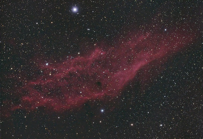 "NGC 1499 - The California Nebula.  So called because of the loose resemblance to the outline of the state of California.  This cloud of hydrogen gas lies about 1,800 light years away and is located within the same spur of the Orion spiral arm of the Milky Way galaxy as Earth.  The hydrogen gas cloud is being illuminated by the star Xi Persei - the bright star at the top of the image. This single blue-white super giant star has an apparent luminosity of 13,500 suns and is approximately 40 times the mass of our sun. Its temperature is also extremely high - six times hotter than the sun (~66,000 degrees Fahrenheit).  Being so massive, the star is destined to go supernova at some point in the next million years or so.  It is one of the hottest and most massive stars visible to the naked eye.  ----------  Field center: RA: 04:00:55.454, DEC: +36 degrees 29' 10.935"" Field size: 2.50 x 1.70 degrees Camera: Modified Canon 300D DSLR @ 800 ISO Filter: None Lens: 80mm Apo F/stop: 6.1"