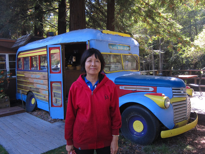 School-bus-turned-snack-shop at a gas station in Big Sur