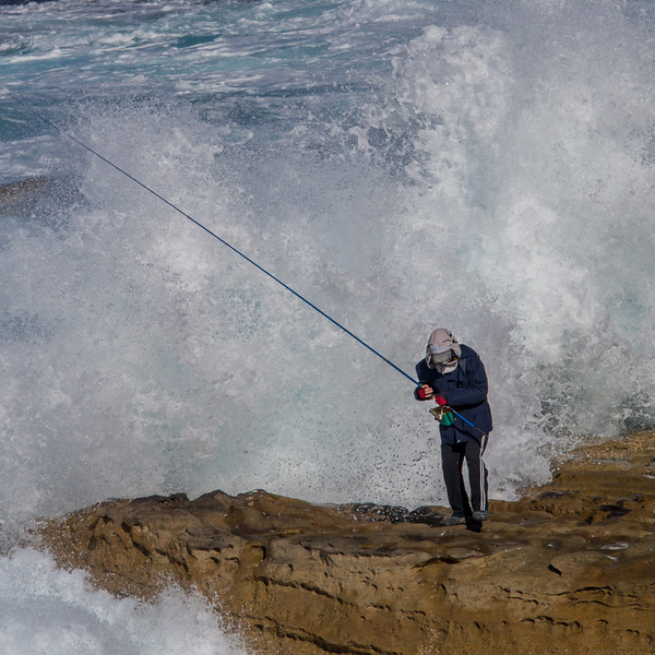 Fisherman escaping wave