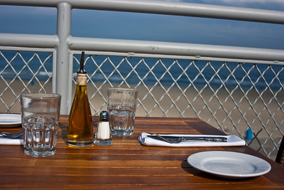 A table on an upper deck as the sun was starting to go down.