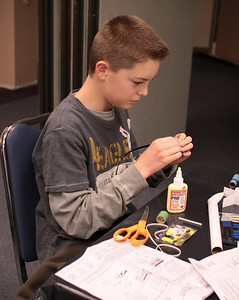 A student assembles his shock cord mount.  You need to use just the right amount of glue.  Photo by Greg Smith