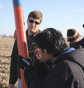 Activating the electronic payloads of the first rocket before launch.  Photo by Greg Smith
