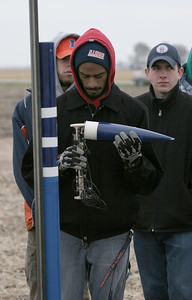 Preparing to insert the payload into the fourth rocket.  Photo by Greg Smith