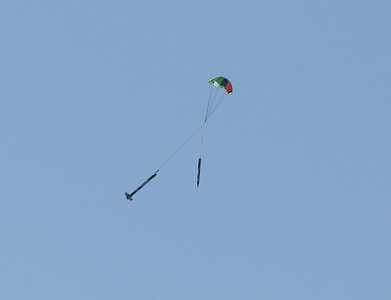 Descent of the third rocket under a full parachute.  Photo by Greg Smith