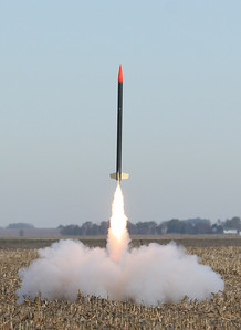 Liftoff!  The first rocket clears the pad with a J350-L motor.  Photo by Greg Smith