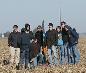 The fourth team to fly, with their blue, orange and black rocket.  Photo by Greg Smith