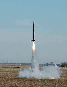 The first of the AE199 class rockets lifts off.  All the class flights used Aerotech I161 motors and reached altitudes near 2000 feet according to the onboard altimeters.  Photo by Alan Carroll