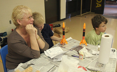 Two young modelers with their newly-completed rockets.  Photo by Greg Smith