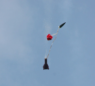 Ejection time.   Abundant recovery wadding is streaming out, but the parachute is not yet fully open.  Photo by Greg Smith