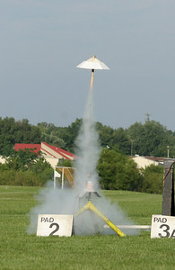 Mark's Lampshade is a model designed to demonstrate the effects of a large frontal area with lots of drag on a relatively light rocket.  It takes off slowly and flies at an almost constant upward speed until the motor burns out.  Photo by Greg Smith