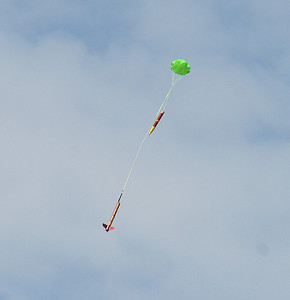 Mark Joseph's BSD 38 Special descends under a bright green parachute.  Photo by Greg Smith