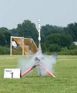 Liftoff of one of the IAI egglofters.  These rockets also carry an electronic altimeter in a compartment just below the egg payload.  Photo by Greg Smith