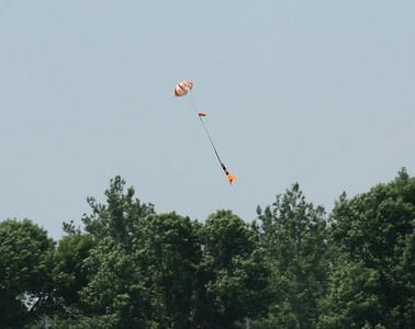 Success!  A rocket descends toward landing under a perfect 'chute.  Photo by Greg Smith