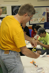 Jonathan Sivier demonstrates how to attach and fold a parachute.  Photo by Greg Smith