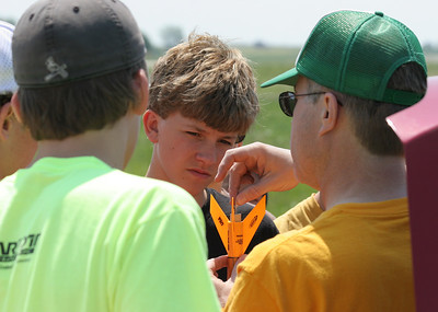 Jonathan shows how to insert the igniter in a rocket motor.  Photo by Greg Smith