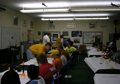 Jonathon, Lon and Greg help the campers build their rockets.  Photo by Christopher Brian Deem