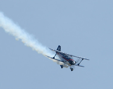 A Pitts biplane performs during the Chanute Air Festival.  Photo by Greg Smith