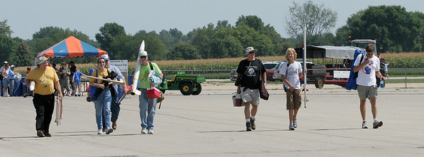 A motley crew of CIA rocketeers marching into the airshow spectator area to man our display tent after the demonstration launch.  From left to right: Lon Westfall, Wendy Gregory, Christopher Deem, Jonathan Sivier, Robert Brunner, Adam Joseph, Mark Joseph.  Photo by Greg Smith