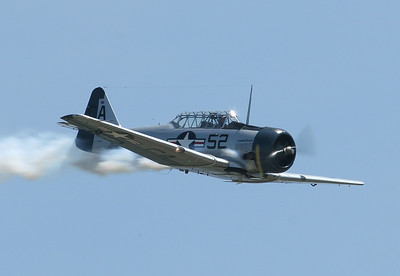 A beautiful SNJ trainer in performance at the Chanute Air Festival.  Photo by Greg Smith