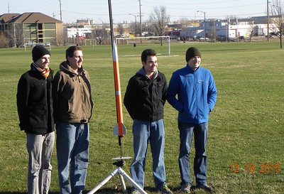 The ISS team with their rocket.