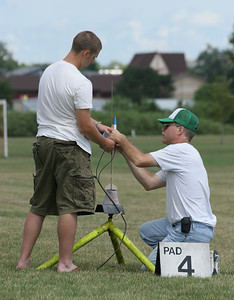 Jonathan helps a student hooking up his glider on the pad.  Photo by Greg Smith