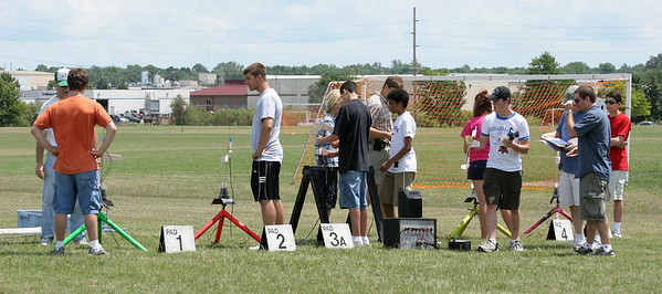Students load their egglofters and boost gliders on the pads before the first launches.  Photo by Greg Smith