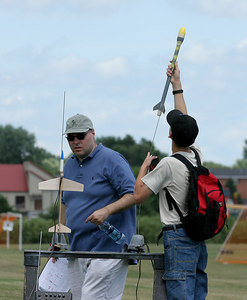 A student loads his egglofter on the pad at the IAI launch on Friday, July 14.  Photo by Greg Smith