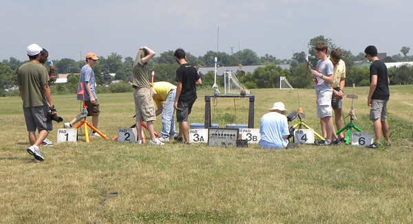 Some of the students load their rockets onto the launch pads. photo by Christopher Brian Deem