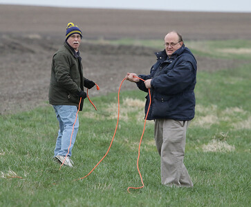 Jonathan and Lon wrangle the 200' extension cord to the far pad while setting up for the launch.  Photo by Greg Smith
