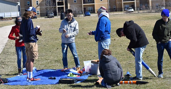 Jonathon Sivier and the students prepare the rockets.