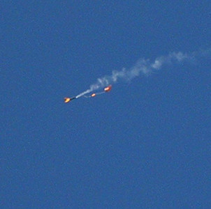 The parachute has unfurled, smoke still coming out of the rocket body. photo by Christopher Brian Deem