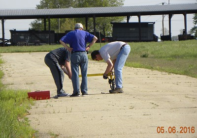 Dan West, Will Carney, and Mark Joseph set up the launch pad.