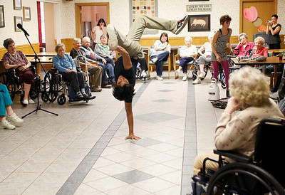 Zachary P. Stephens/Reformer Reyie Delgado, a student from the New England Center for Circus Arts, performs for the residents of the Thompson House Nursing Home in Brattleboro, Tuesday.