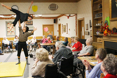 Zachary P. Stephens/Reformer Naomi Beard and Reyie Delgado, students from the New England Center for Circus Arts, perform for the residents of the Thompson House Nursing Home in Brattleboro, Tuesday.