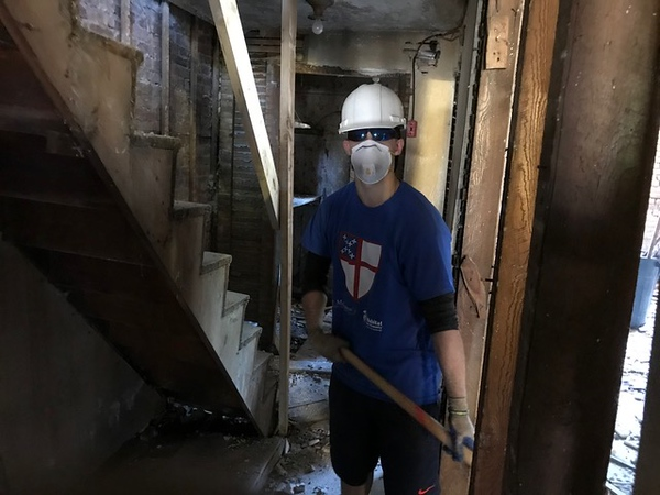 Basement work called for hardhat, protective goggles and facemark protection.