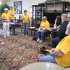 Group leader and Washington Conference Disaster Response Coordinator, Debra Finley (center standing) briefs the group before work.