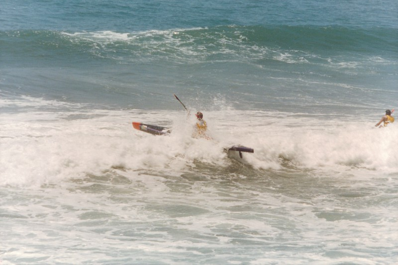 Geoff Graf paddles out through the surf