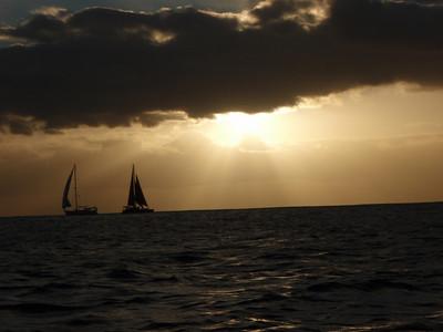 Sunset and Sailing Ships