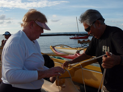 Bea and Les Rigging a Canoe
