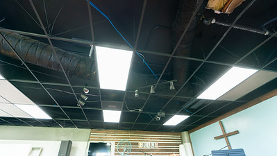 Before - Closeup of stage lighting in ceiling.